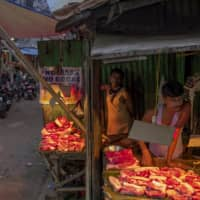 A meat stall at a market in Agartala, the capital of India's Tripura state. | ANINDITO MUKHERJEE/THE NEW YORK TIMES
