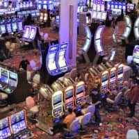 The central government is set to postpone the procedure to accept bids from municipalities to host casino resorts, which was originally scheduled to start in January. | KYODO
