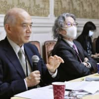 Takashi Onishi (left) and Seigo Hirowatari, former chiefs of the Science Council of Japan, attend a hearing held by opposition lawmakers in the Diet building Friday. | KYODO