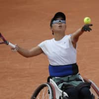 Momoko Ohtani plays a shot against Diede de Groot in the women's wheelchair semifinal of the French Open on Thursday in Paris. | AP