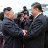 North Korean leader Kim Jong Un shakes hands with Chinese President Xi Jinping during Xi's visit in Pyongyang in this picture released on June 21, 2019. | KCNA / VIA REUTERS