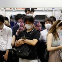 A recent survey showed that 83.6 percent of respondents in Japan said they wear masks when talking to others at a close distance, while 13.3 percent said they sometimes don't wear masks in such situations. | REUTERS