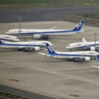 ANA's parent company, ANA Holdings Inc., in July reported a record net loss of ¥108.82 billion in the April-June quarter, citing reduced demand for air travel. | KYODO