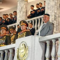 North Korean leader Kim Jong Un attends a military parade during a ceremony to mark the 75th anniversary of the Workers' Party of Korea at Kim Il Sung Square in Pyongyang on Saturday.  | KCNA / KNS / VIA AFP-JIJI