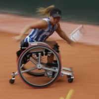 Yui Kamiji plays a shot during her win in the French Open women's wheelchair final on Friday in Paris. Kamiji failed to clinch the women's doubles title on Saturday with her partner Jordanne Whiley. | AP