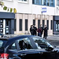 Dozens stage attack on police station in Paris suburb