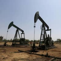 Even when the pandemic subsides, the pre-existing threat from the shift away from carbon-based fuels won't. Both BP and France's Total SE now see global oil demand plateauing at close to 100 million barrels a day by 2030, before starting to fall. | REUTERS
