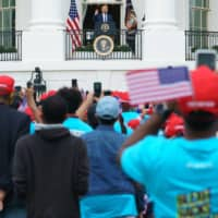 U.S. President Donald Trump speaks from the South Portico of the White House during a rally on Saturday. | AFP-JIJI