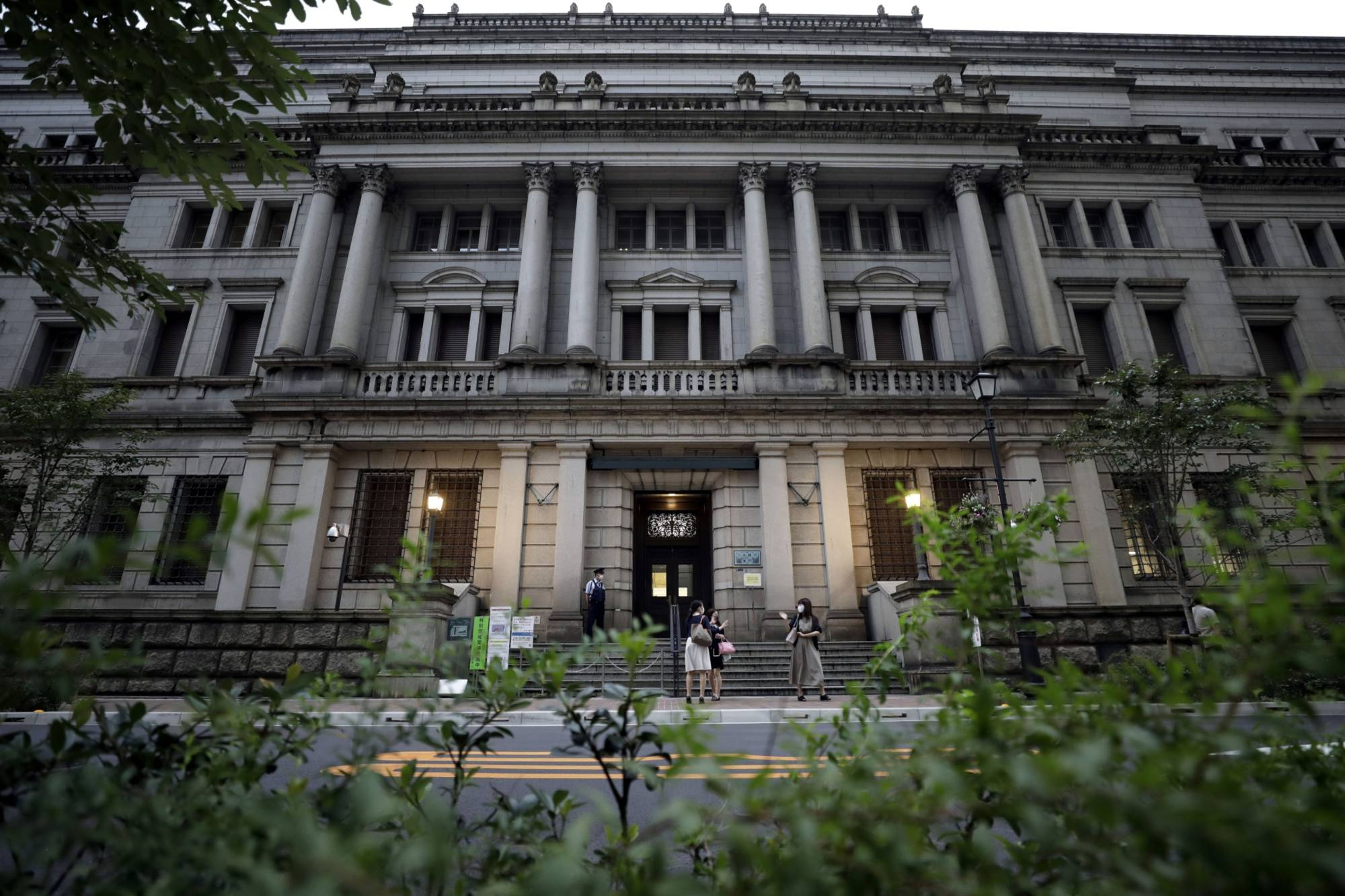 The Bank of Japan's growing pile of assets is complicating its strategy to exit stimulus, economists say. | BLOOMBERG