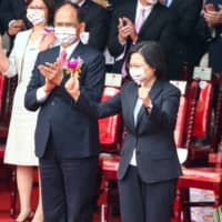 Tsai Ing-wen, Taiwan's president, during National Day celebrations in Taipei on Saturday. Tsai called for dialogue with Beijing while vowing to defend the island in the face of Chinese intimidation.