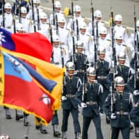 Members of National Defense Honor Guard march during National Day celebrations in Taipei on Saturday. | BLOOMBERG