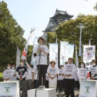 Members of the Liberal Democratic Party's Osaka chapter express their opposition to the Osaka metropolis plan in stump speeches to voters as campaigns for a referendum kicked off in the city on Monday. | KYODO