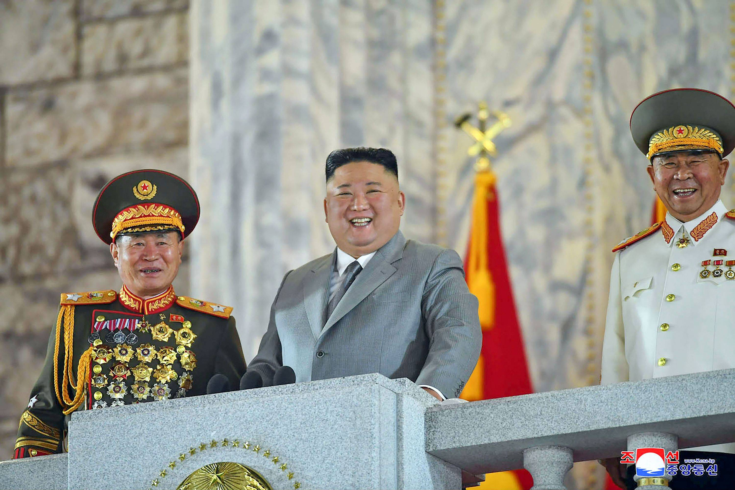 North Korean leader Kim Jong Un attends a military parade during a ceremony to mark the 75th anniversary of the Workers' Party of Korea, in Pyongyang's Kim Il Sung Square on Saturday. | KCNA / KNS / VIA AFP-JIJI