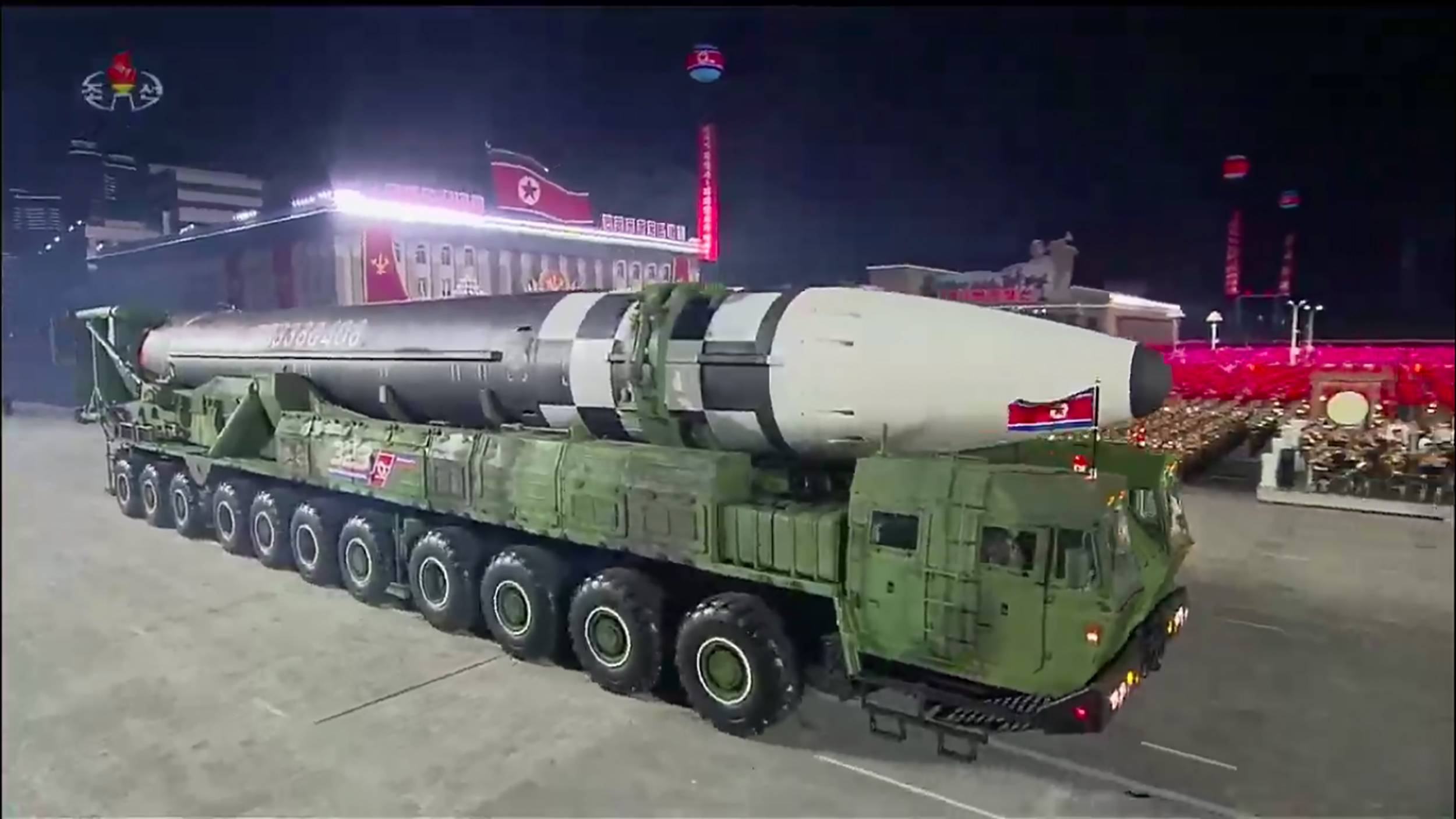 A new North Korean intercontinental ballistic missile is displayed during a military parade marking the 75th anniversary of the founding of the Workers' Party of Korea, in Pyongyang's Kim Il Sung Square on Saturday. | KCNA / KNS / VIA AFP-JIJI
