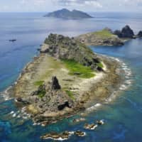 Japan protests after Chinese ships approach fishing boat near Senkakus