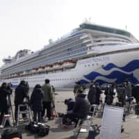 Japan to seek international rules on states' response to infection-hit ships