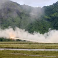 U.S. military forces fire a High Mobility Artillery Rocket System rocket during a live fire amphibious landing exercise in the Philippines in 2016. | REUTERS