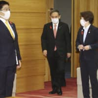 Prime Minister Yoshihide Suga attends a Cabinet meeting at his office on Tuesday. | KYODO