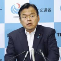 Tourism minister Kazuyoshi Akaba speaks at a news conference Tuesday in Tokyo. | KYODO