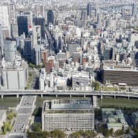 On Nov. 1, Osaka residents will vote on whether to merge the city's existing districts into four large, semiautonomous wards. | KYODO