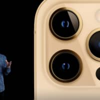Apple's Senior Vice President of Worldwide Marketing Greg Joswiak unveils the all-new iPhone 12 Pro at a special event at Apple Park in Cupertino, California, in a still image from a video released Tuesday. | APPLE / VIA REUTERS