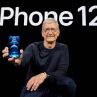 Apple CEO Tim Cook holds the all-new iPhone 12 Pro. | APPLE / VIA REUTERS