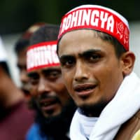 Rohingya living in Malaysia protest against the treatment of Myanmar's Rohingya Muslims near the Myanmar Embassy in Kuala Lumpur in 2017. | REUTERS