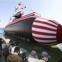 Japan unveils new submarine in face of China's growing assertiveness