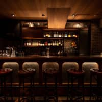 Sophisticated space: Low-Non-Bar has all of the hallmarks of a top-notch cocktail joint — dark-wood interior, soft lighting and white-jacketed barmen — except the high-octane alcohol. | IKUNORI YAMAMOTO