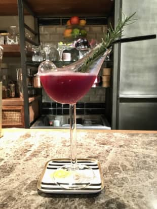 Guilt-free tipple: Low-Non-Bar's signature cocktail — which combines mixed berries and red pepper with zippy orange and ginger shrub — comes in a delightful bird-shaped flute. | MELINDA JOE