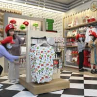 Goods inspired by characters from the Super Mario Bros. game series are sold at the Mario Cafe & Store at Universal Studios Japan in Osaka. | KYODO