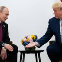 U.S. President Donald Trump meets with Russian President Vladimir Putin during the G20 summit in Osaka in June last year.  | ERIN SCHAFF/THE NEW YORK TIMES