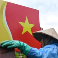 Vietnam's communist regime has long made a practice of harassing, beating and imprisoning outspoken activists. | AFP-JIJI