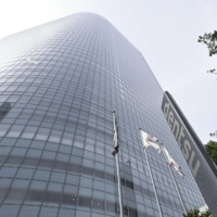 Dentsu Inc. stands accused of providing $6.2 million to Tokyo's Olympic bid campaign, despite having a contract with the IOC to market the games. | KYODO