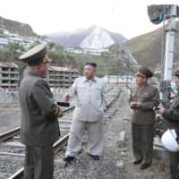 North Korean leader Kim Jong Un inspects a damage recovery site affected by heavy rains and winds caused by recent typhoons in South Hamgyong province in a photo released Tuesday.