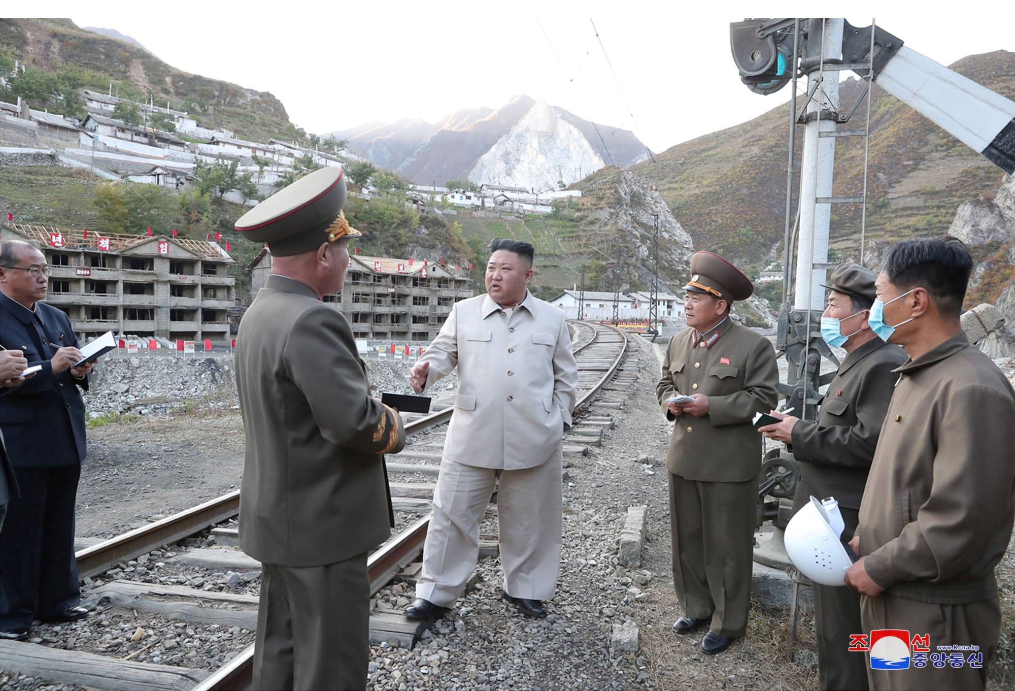 North Korean leader Kim Jong Un inspects a damage recovery site affected by heavy rains and winds caused by recent typhoons in South Hamgyong province in a photo released Tuesday.  | KCNA / VIA REUTERS