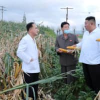 North Korean leader Kim Jong Un inspects the typhoon-damaged area in South Hwanghae Province, North Korea, earlier this year.  | KCNA / VIA REUTERS