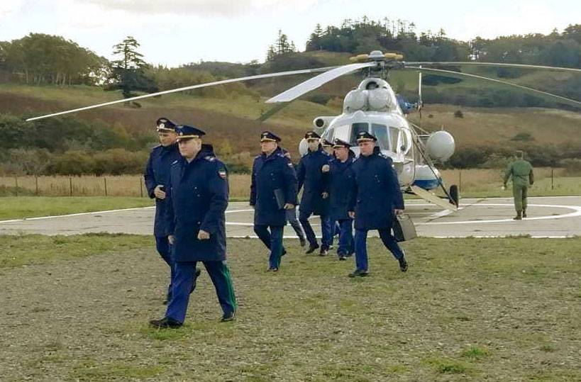 A photo supplied by a resident of Shikotan island shows Russian Prosecutor General Igor Krasnov (foreground) arriving on the island Friday. | KYODO