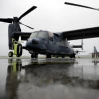 A V-22 Osprey tiltrotor aircraft is seen during a military drill at Yokota Air Base in Fussa, Tokyo, in May. Japanese and U.S. officials on Friday wrapped up two days of preparatory talks on defense cost-sharing. | REUTERS