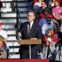Sen. David Perdue speaks during a campaign rally for President Donald Trump at Middle Georgia Regional Airport on in Macon, Georgia. | AP
