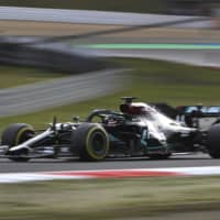 Lewis Hamilton drives during the Eifel Grand Prix at the Nuerburgring racetrack in Nuerburg, Germany, on Oct. 11. | AP