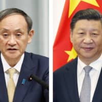 Prime Minister Yoshihide Suga and Chinese President Xi Jinping | KYODO