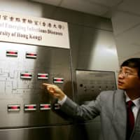 Yuen Kwok-Yung of the University of Hong Kong introduces a newly set up state laboratory for the study of emerging infectious diseases in Hong Kong in 2004.    REUTERS