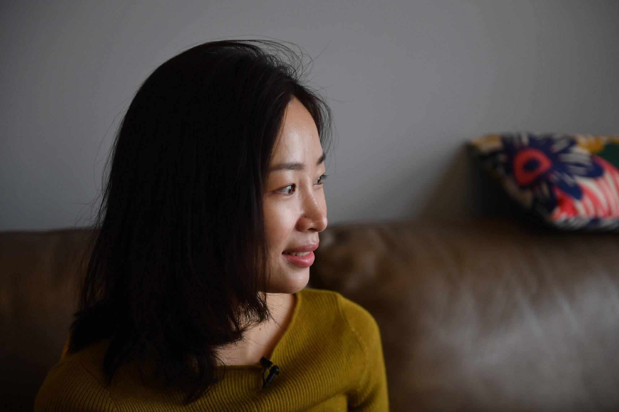 Sex and relationships advice blogger Yi Heng, who runs discussion groups on the topic of sex toys, poses for a photo at her home in Beijing on Wednesday. | AFP-JIJI