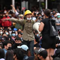 Pro-democracy protesters attend an anti-government rally at Wongwian Yai in Bangkok on Saturday.  | AFP-JIJI