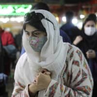 A woman walks through a traditional bazaar in northern Tehran on Thursday. 'Made in Iran' has emerged as a rare glimmer of hope in the financial destruction from being ostracized from the oil market and global trade while COVID-19 rages. | AP