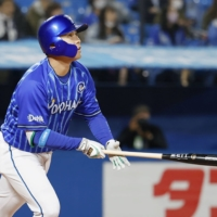 Keita Sano homers against the Swallows during the second inning on Thursday at Jingu Stadium. | KYODO