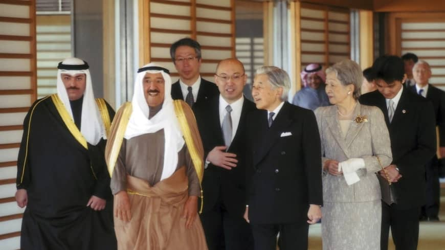 Above: The late amir of Kuwait (second from left) is escorted by Emperor Emeritus Akihito and Empress Emerita Michiko  through the Imperial Palace during a 2012 state visit to Tokyo.  | REUTERS / IMPERIAL HOUSEHOLD AGENCY OF JAPAN