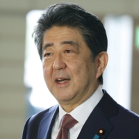 Abe visits war-related Yasukuni Shrine for second straight month