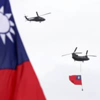 Helicopters fly over Taipei during national day celebrations on Oct. 10.  | AP